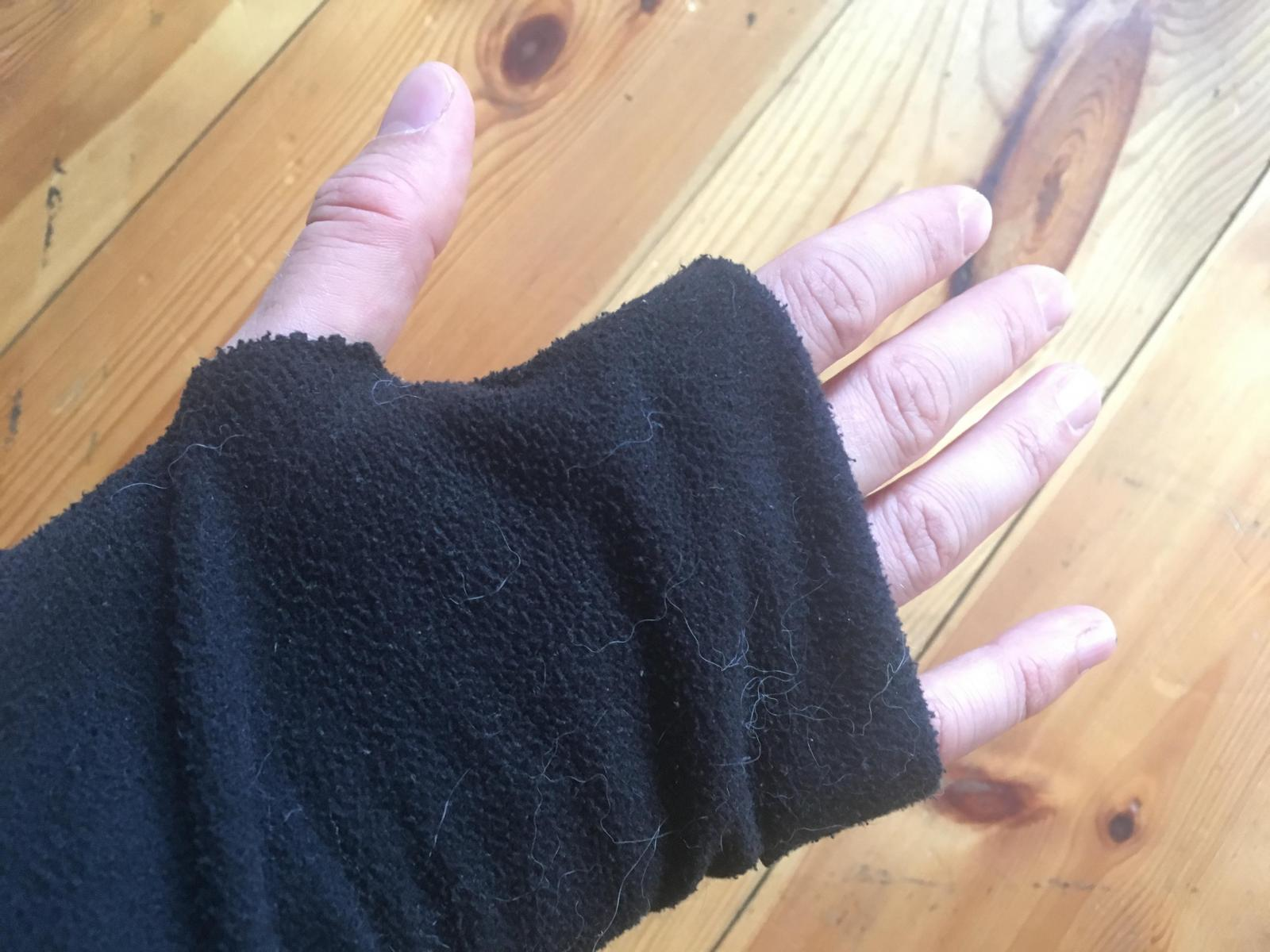Unibody Black Fleece Detail worn thumbloop.jpg